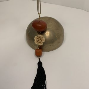 African Amber with Carved Flower and Tassel on Adjustable Tan Deer Leather String